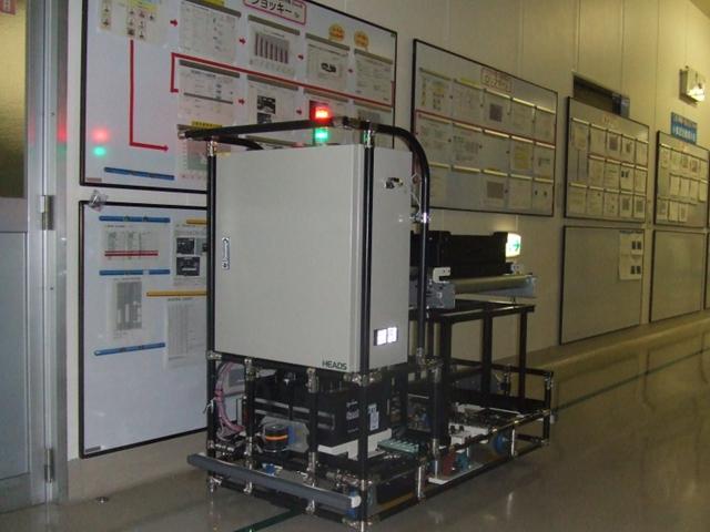 積載型 AGV(半導体部品搬送)